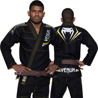 Venum Elite Jiu Jitsu Gi in Black and yellow.  Now available at www.thejiujitsushop.com Front of gi in black and yellow  Enjoy free shipping from The Jiu Jitsu Shop