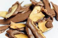 Milk chocolate covered dry mango