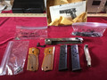 Assorted Smith & Wesson 9mm Model No. 39 parts and 8 round magazines