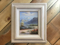 Art oil painting. Desert, Cactus, Mountains and Sky. White frame
