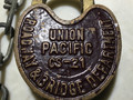 SOLD Heart shaped Union Pacific Railroad lock, no key. Brass was painted partially nice shape