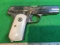 M1903 Pocket Hammerless .32 ACP nickel plated, ivory grips.