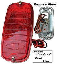 This fleetside tail lamp assembly with bowtie fits 1960-66 Chevrolet pickup trucks.