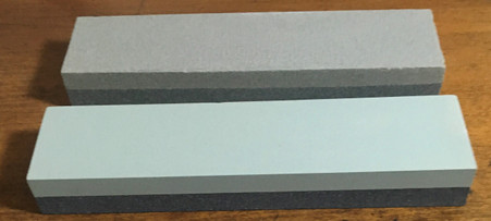 Top stone is for tempered steel (grey/green) Bottom stone is for Carbide (light green/dark green)