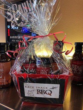 Saucy Special Gift Basket  2 Sauces, 1 bottle 17 Spice Rub, $25 Gift Card Available in the restaurant for quick pickup!