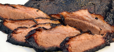 This is a whole, untrimmed, Old No. 17 Dry Rubbed, Smoked BBQ Beef Brisket. You'll feed 20-25 of your mouth watering friends or family members with this savory specimen.