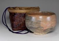 sale: Nodate Chawan - Aka raku bowl w bamboo basket by Shoraku