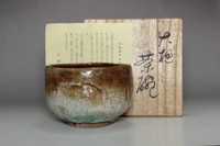 sale: Amber glazed tea bowl in Ohi ware by Ohi Rakutaro