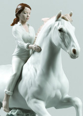 Riding her horse on the seashore Horse & Woman Figurine 01009371