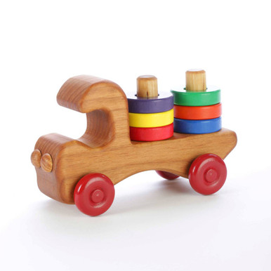 Our wooden stacker truck features six brightly colored removable wooden rings for teaching colors and hand-eye coordination. Made of locally-harvested Oregon alder and finished with non-toxic paints and food-grade mineral oil. Handcrafted in Oregon, USA.