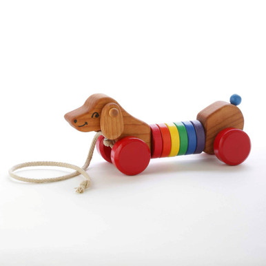 A favorite with toddlers, our wobble pull puppy bounces up and down and the ears swing back and forth when pulled. Made of locally-harvested alder wood and finished with non-toxic paints and food-grade mineral oil. Choose red, yellow, or blue wheels. Ages 1 - 4. Dimensions: 10.5 inches long; 20 inch organic hemp pull cord. Handcrafted in Oregon, USA.
