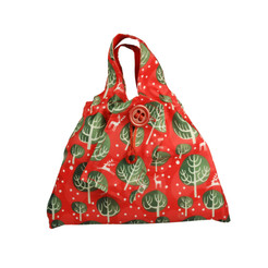 Small fabric Gift Bag in Red Berry.  Shown wrapping example gift.