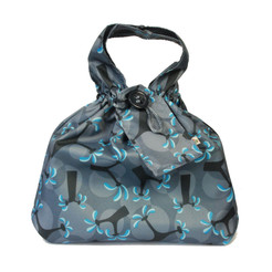 Medium fabric Gift Bag in Ocean Blue.  Shown wrapping example gift.