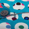 Pass the cord and button through the buttonhole to use the reverse side to wrap - easy!