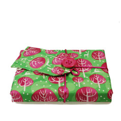 Small Crackle fabric wrap in Neon Pink.  Shown wrapping a paperback novel.