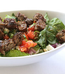 Charbroiled seasoned ground beef served over romaine lettuce with fresh diced tomatoes, cucumbers, green peppers, black olives, red onions, and parsley tossed in extra virgin olive oil and fresh lemon juice.