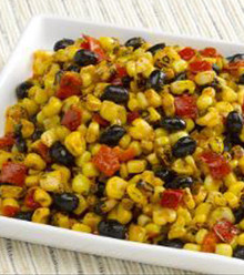 Black beans, corn, diced onion, red and green peppers tossed in a red wine vinegar dressing, and seasoned with a pinch of cayenne.