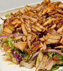 Sizzling marinated chicken cooked on a vertical spinning grill, served over salad and tossed with extra virgin oil and lemon juice.