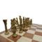Rex Noir Prestige Roman Series Brass Chess Pieces (PRE-ROM-85) light on board