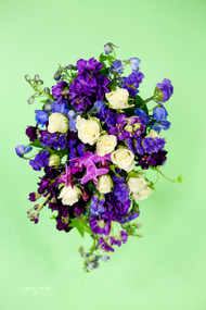 Just in love with purples, this is just the answer, with stock, delphinium, orchids, statice and a touch of white roses.