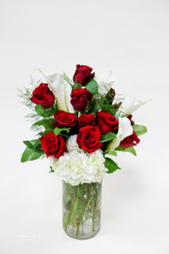 A One of a Kind fresh flower arrangement! Premium long stem red roses, hydrangea, and white calla lilies! A beautiful vase of specialty flowers for that special occasion!