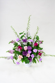 mix of violet and pink fresh flowers sympathy tribute