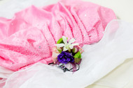 mixed fresh flower corsage accented with a variety of colors