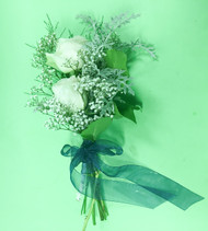 Sometimes simple just works best, with white roses, baby's breath,   dusty miller and other greens and a coordinating ribbon.