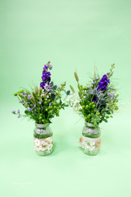 Brides mason jars filled with wild grasses, purple larkspur, green hypericum berries for that touch of interest!!