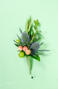 Wild berry and blue thistle wedding boutonniere.