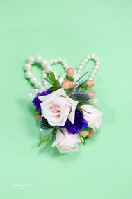 Pearl wristlet is a great base for summer mix or white spray roses, thistle, and touch of purple.