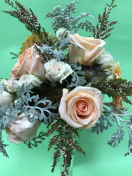 Summer bouquet for soft peach roses, very cool dusty miller, gerberas, spray roses, calcynia and don't leave out the succulent, just love the color!