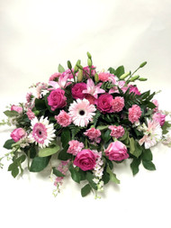 Pink and White Sympathy Spray with a mix of beautiful flowers including Local Grown Lilies, Gerbera Daisies and Roses.