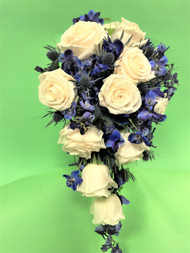 Thistle is a traditional flower used in royal wedding, so why not add it to your bouquet, seen here is ivory roses and blue delphinium, for your own royal wedding!