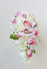 Just perfect for the romantic bride.  Cascading bouquet  of cymbidium orchids soft pink and ivory roses, wonderful ivory dahlias.