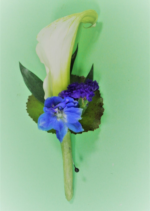 white Cala Lily Boutonniere with blue accent