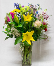 A mix of fresh flowers designed with bright colors