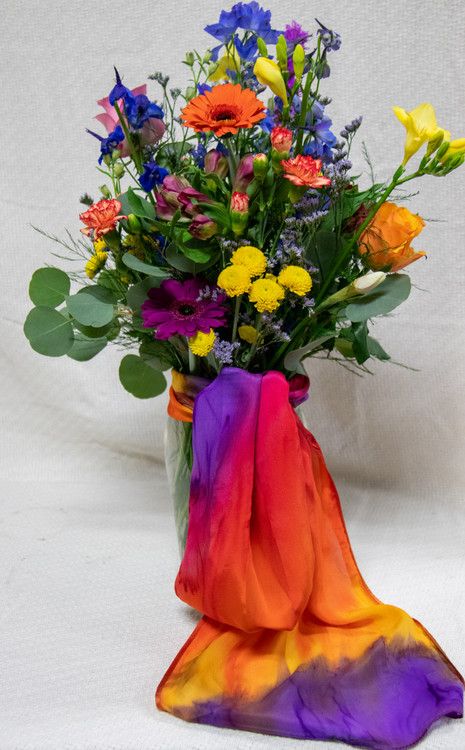 Send her a stunning mix of Spring Flowers designed in a premium vase and add a silk scarf from Silk Sensations!
