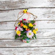 One of our most requested arrangements! Give this unique fresh flower arrangement for any occasion! A classic mixture of bright colors in a decorative pot, makes for a great keepsake after the flowers have gone. Accented with a handle of curly willow, a bright bird and bow and for some extra fun.
