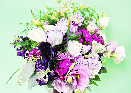 Fifty Shades of Purple Mixed bridal Bouquet designed with a variety of fresh flowers in beautiful shades of purple