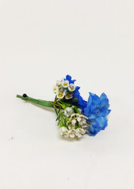 Beautiful Blue and white Boutonniere designed by your Loveland Florist.