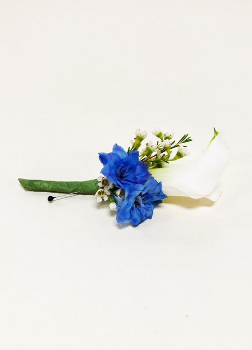 White calla lily with blue hybrid delphinium accent.