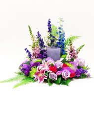 Gorgeous Purple mixed flower urn wreath with a variety of fresh flowers and colors