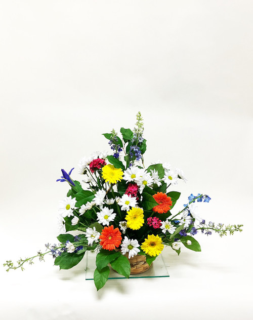 Beautiful mix of yellow red and white fresh flowers designed in a bright sympathy fan style tribute