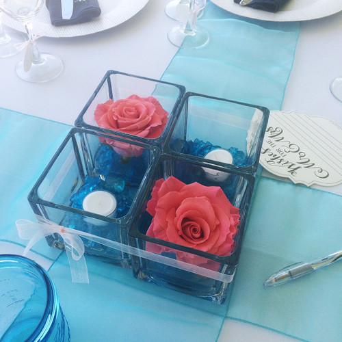 Pink and Aqua wedding cube centerpiece. Simple beautiful fresh roses