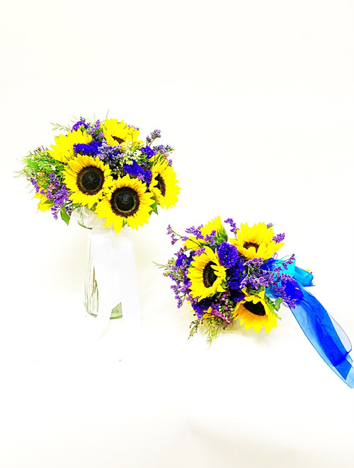 Sunflowers with blue, green and purple accents are just right for a more casual bride. Here are bride bouquet and her bridesmaid bouquet for a complete look.