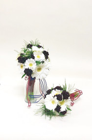 Bouquets of white gerberas accented with dark burgundy dianthus for a late summer look.