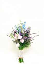 Wildflower hand tied bouquet of delphinium, lisianthus and variety of summer filler flowers have that just picked look, tied with burlap and lace.