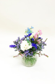 Bubble bowls might be the answer, wildflowers in whites, pinks and purple make a casual arrangement for receptions.