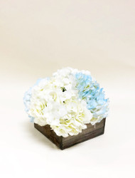 Elegant and rustic work perfectly here, white and blue hydrangea in a rustic wooden box.